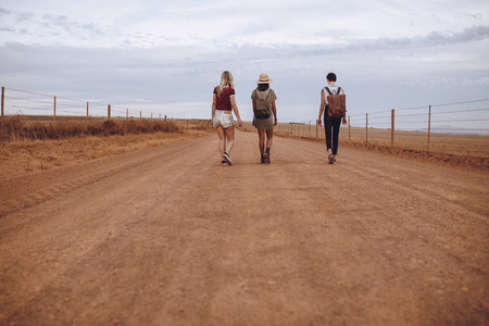 Women walking down the country road