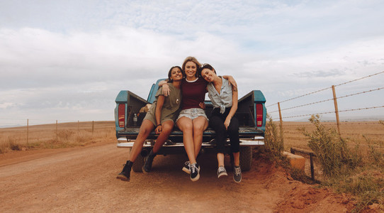 Women on a country side road trip