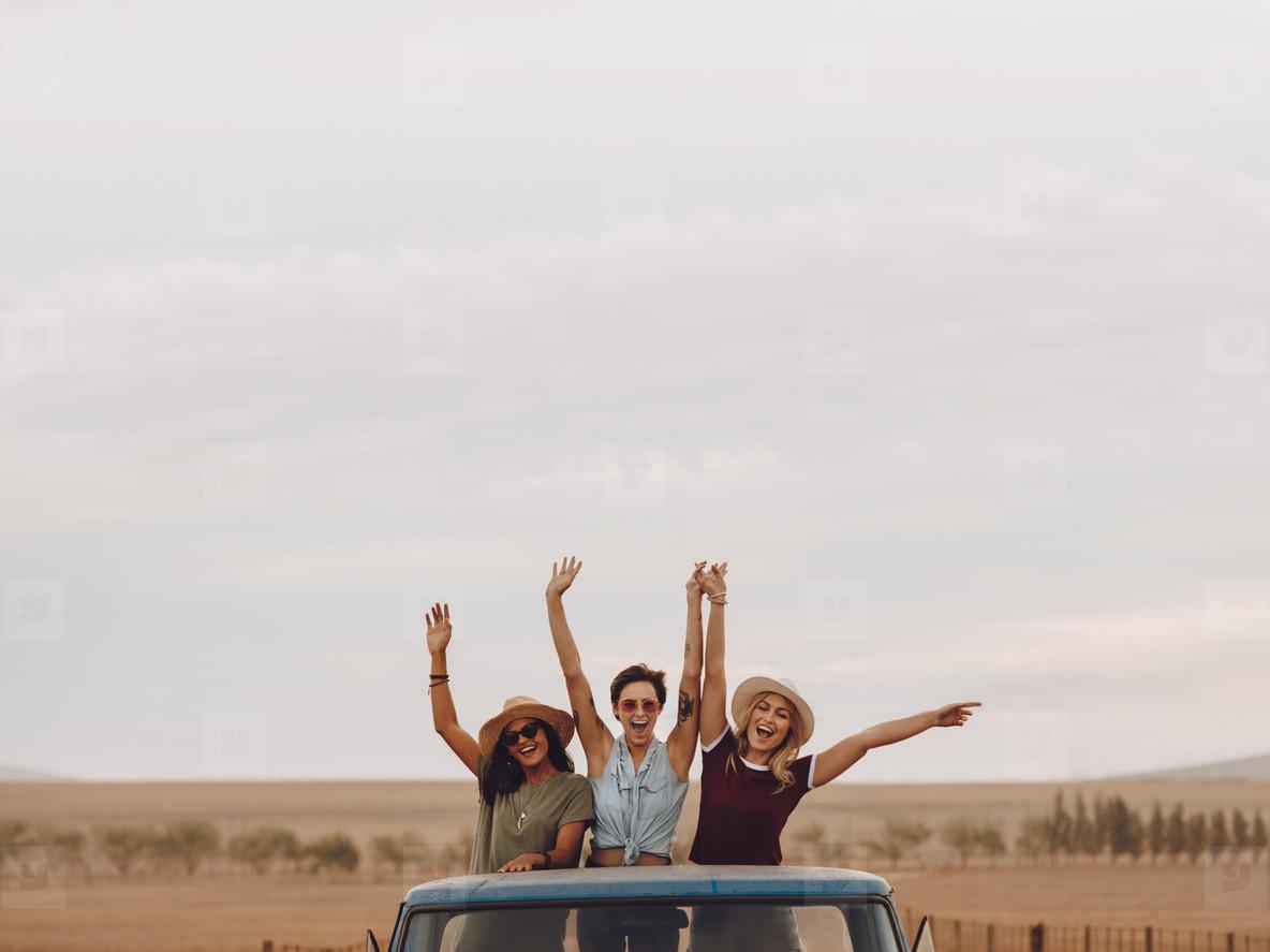 Friends having fun in the open back of a truck