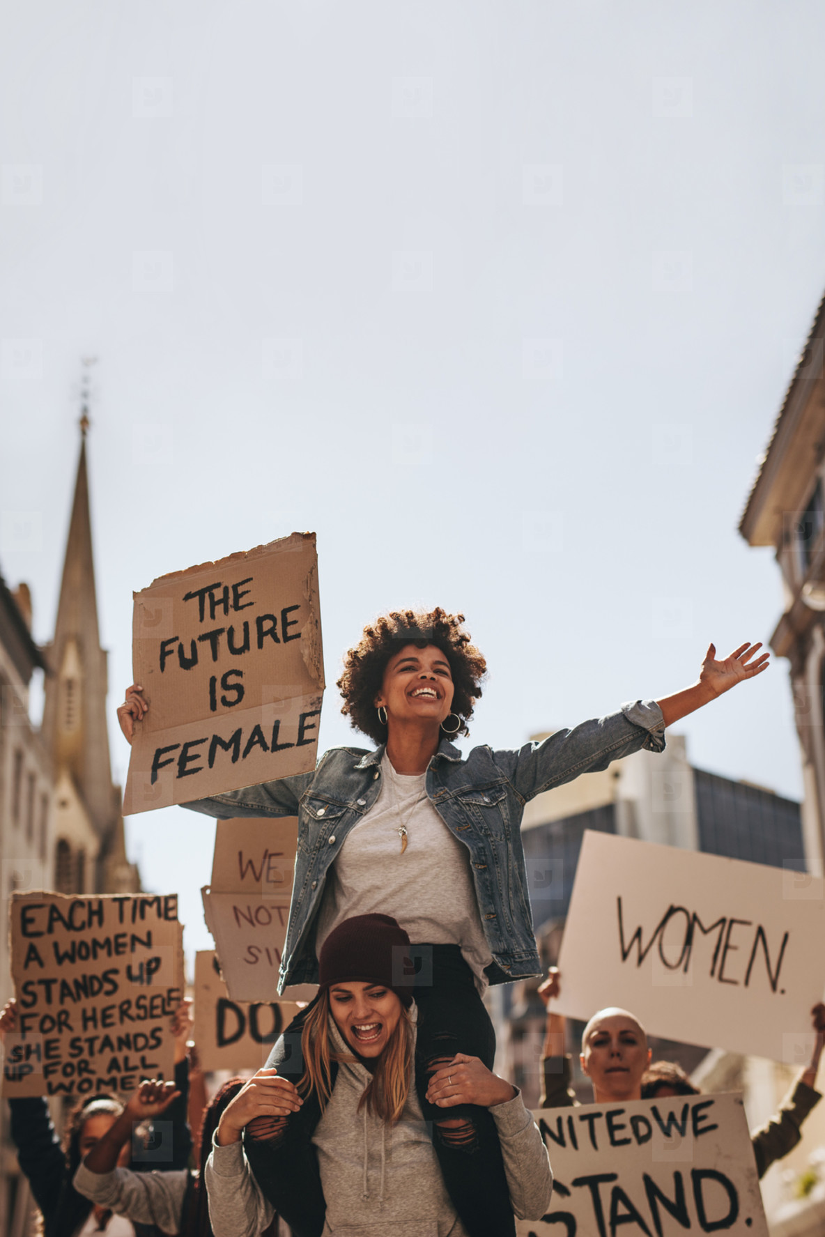 Female demonstrators enjoying the protest on road