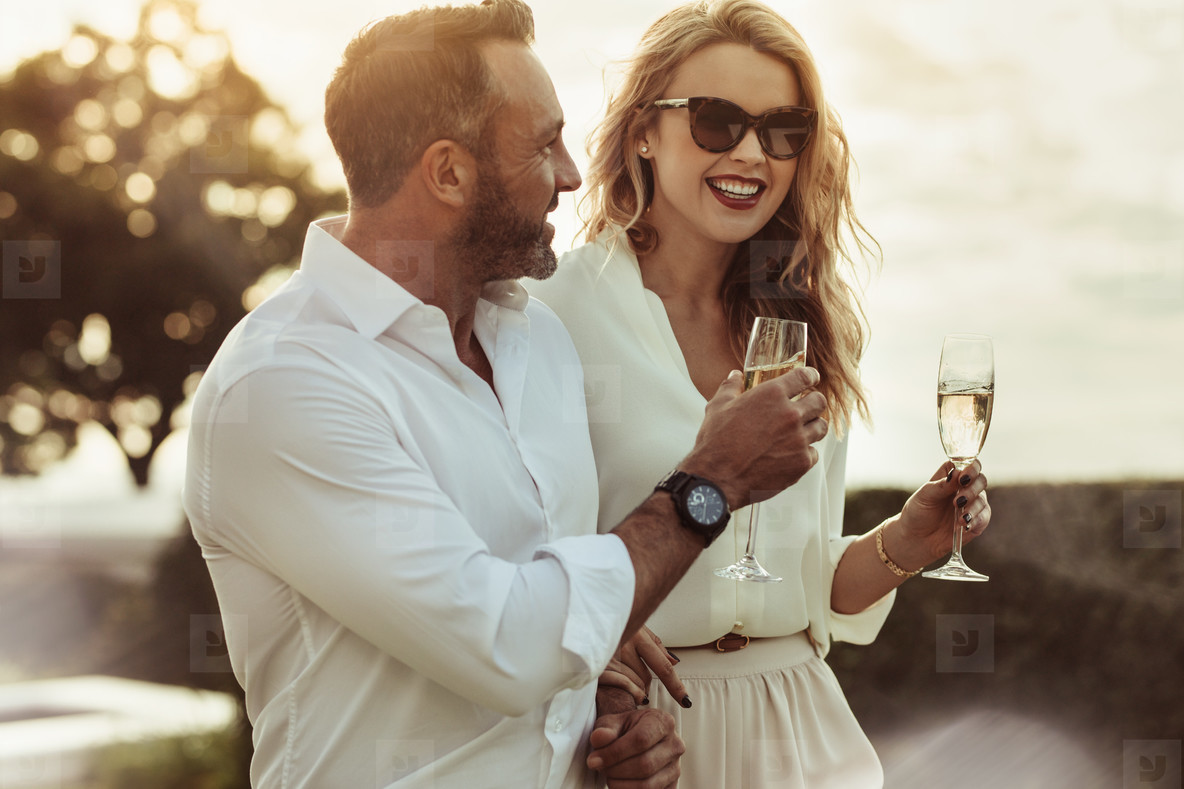 Smiling couple enjoying a glass of wine