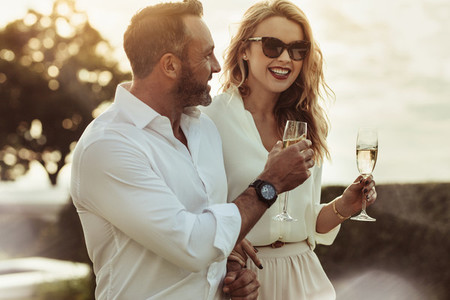 Smiling couple enjoying a glass of wine