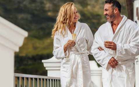Loving couple in bathrobe at luxury villa