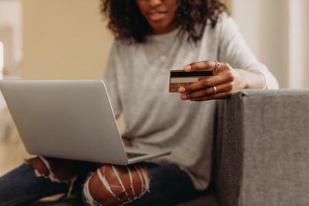 Woman making online transaction using credit card