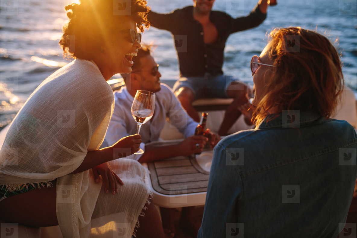 Woman enjoying a boat party with friends