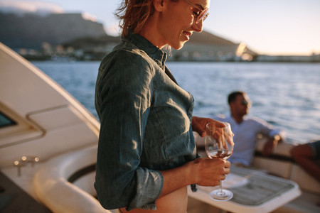 Woman partying on private boat with friends