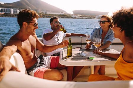 Happy friends having boat party