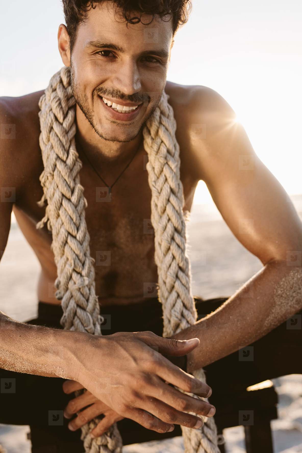 Man relaxing at the beach after workout