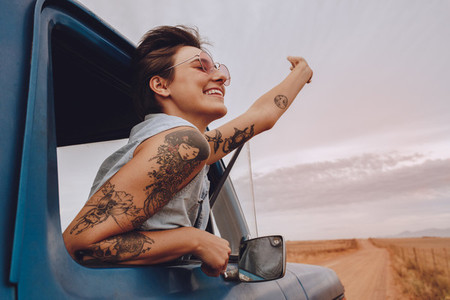 Attractive young woman enjoying on a road trip