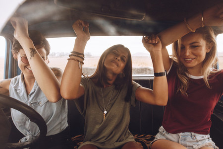 Friends enjoying traveling in the car