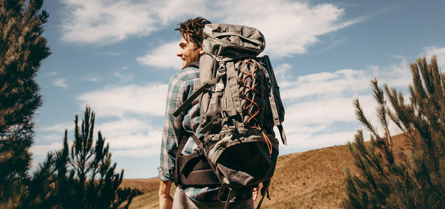 Man with backpack going on a camping