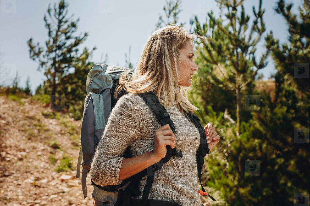 Woman exploring nature while hiking