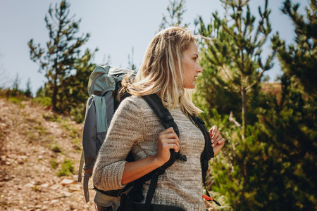 Woman exploring nature while hiking