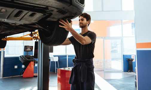 Professional car mechanic working in garage