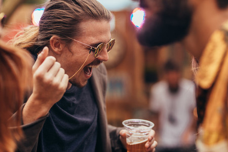 Hipster having a great time at music festival