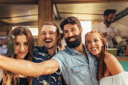 Friends taking selfie at summer festival