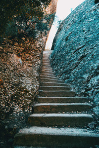 Climbing stairs with two large stones on the sides