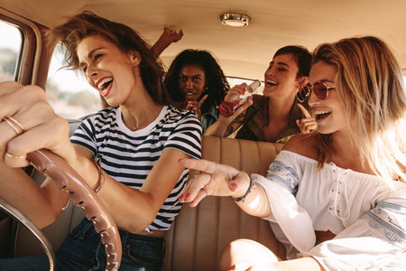 Friends traveling in car and having fun