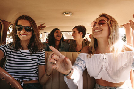 Women enjoying themselves on a road trip