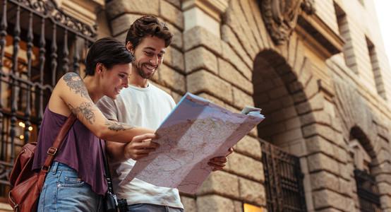 Tourist couple exploring the city