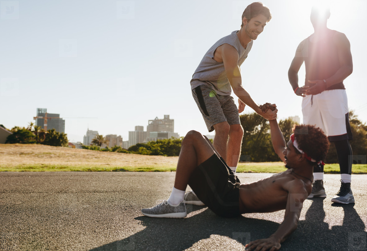 Man lifting teammate