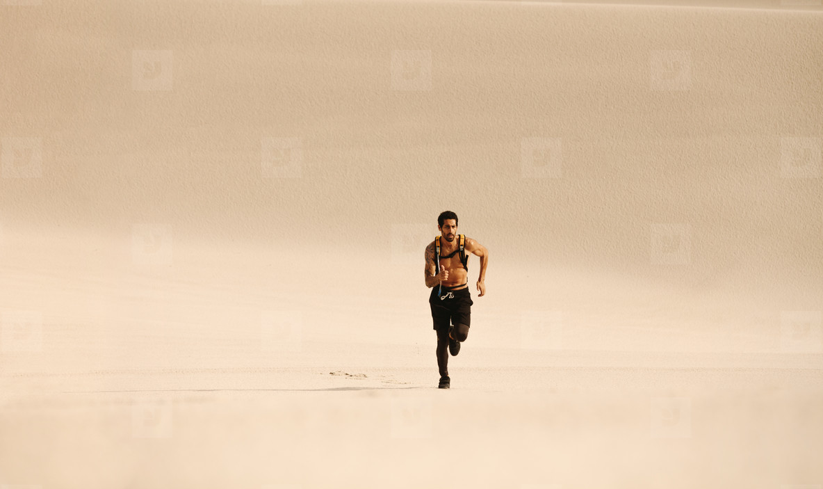 Fitness man running n desert