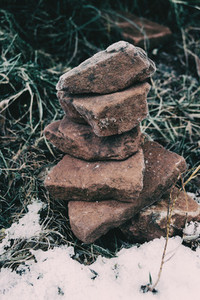 Stones placed one on top of the other frozen by the cold