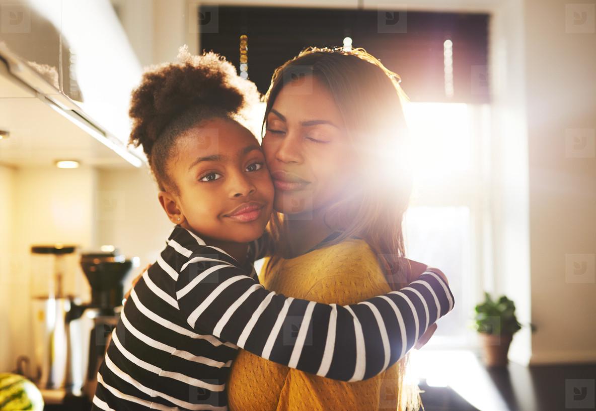 Loving child hugging mother