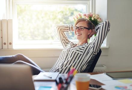 Happy contented businesswoman
