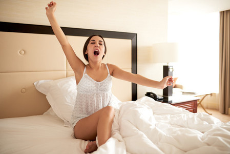 Woman sitting up in bed