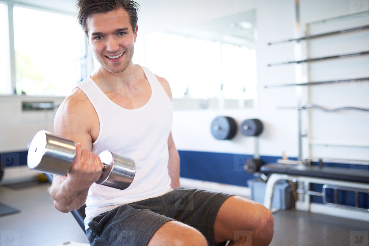 Active Athletic Guy Lifting Weights in the Gym