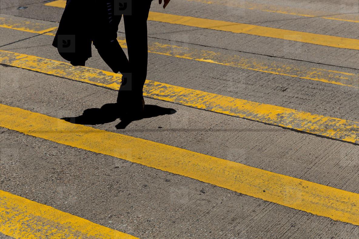 Businessman wearing suit crossing road in Hong Kong