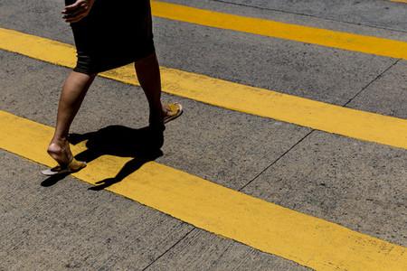 Woman crossing the road in Hong Kong