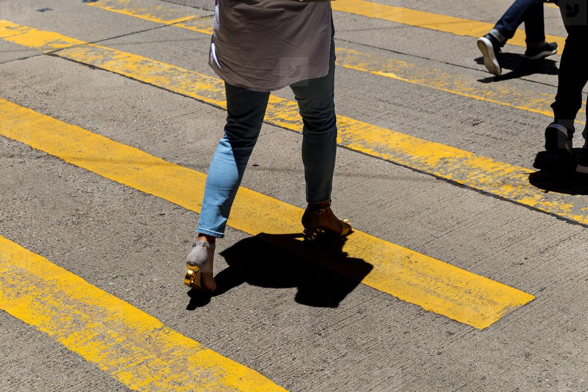 Walking woman crossing road at Causeway Bay shopping district Ho