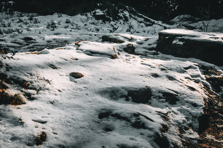 Semi covered stones by snow