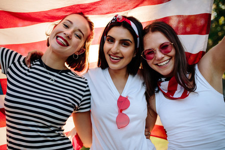 Friends smiling with American flag