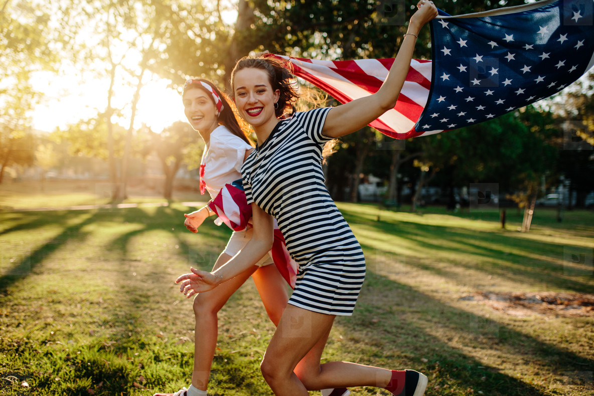 Female friend running with American flag