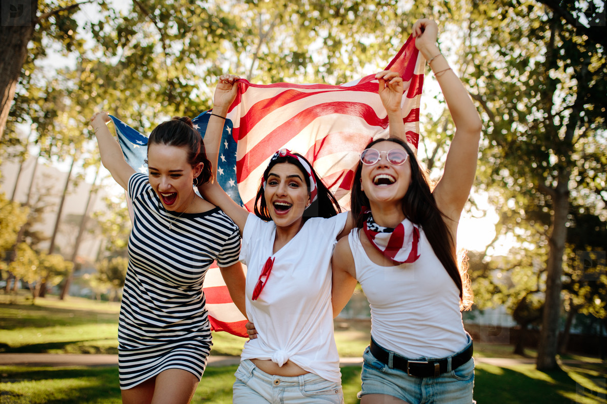 Enthusiastic American girls celebrating independence day