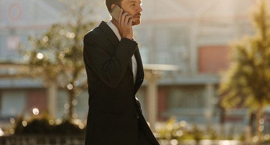 Man talking over mobile phone outdoors