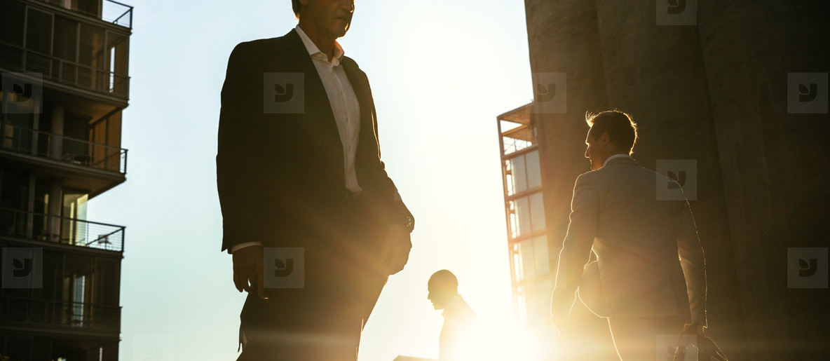 Business people walking on a busy street to office early in the