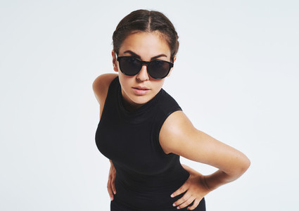 Provocative young woman in trendy sunglasses