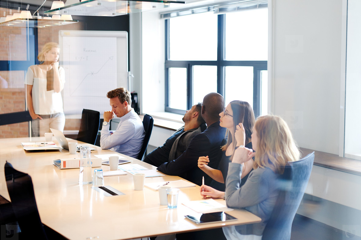 Female white executive leading a meeting