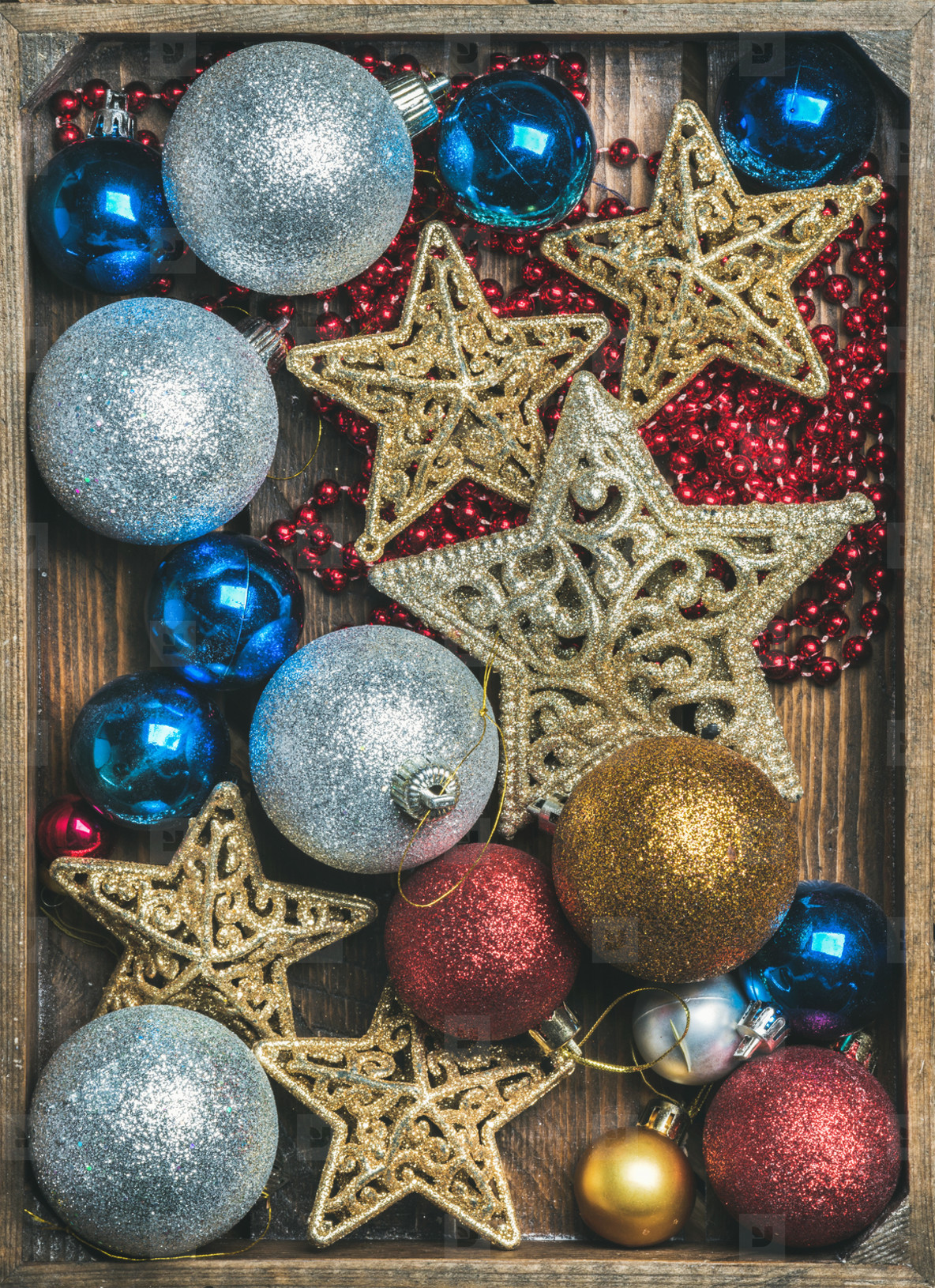 Christmas tree glittering toy stars  colorful balls and garland