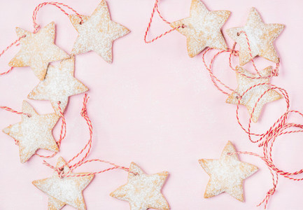 Christmas gingerbread star shaped cookies with sugar powder and rope