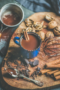 Homemade rich hot chocolate with nuts and cinnamon