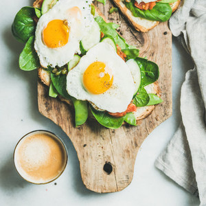 Healthy breakfast sandwiches and cup of coffee square crop