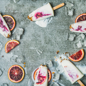 Orange  yogurt  granola popsicles on ice cubes  square crop