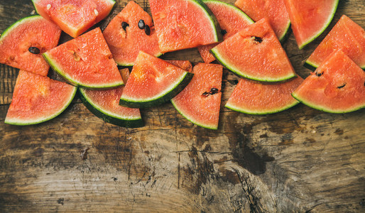 Juicy watermelon pieces over rustic wooden background