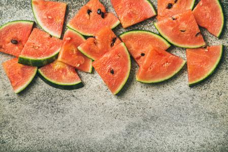 Juicy watermelon pieces over concrete stone background