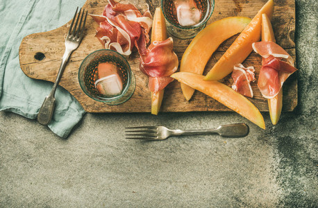 Summer wine party set with rose wine  prosciutto and melon